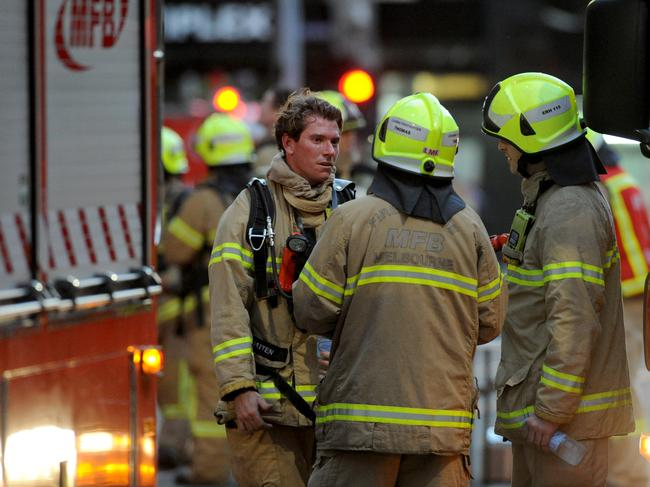 Fire crews at the scene of an apartment tower on the corner of Spencer and Little Bourke Streets Melbourne. Picture: Andrew Henshaw