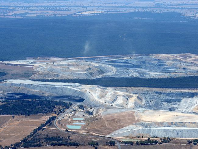 What an open-cut mine looks like from the air: The Boggabri Coal and Whitehaven mines on the edge of Leard State Forest. Picture by Peter Lorimer