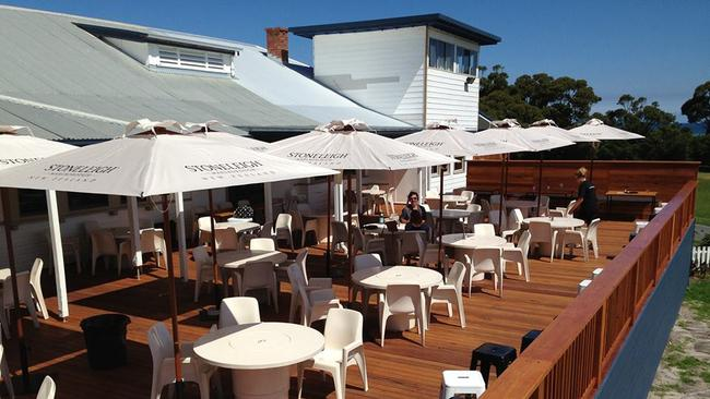 Grab a beer and enjoy the deck of the Marlo Hotel.