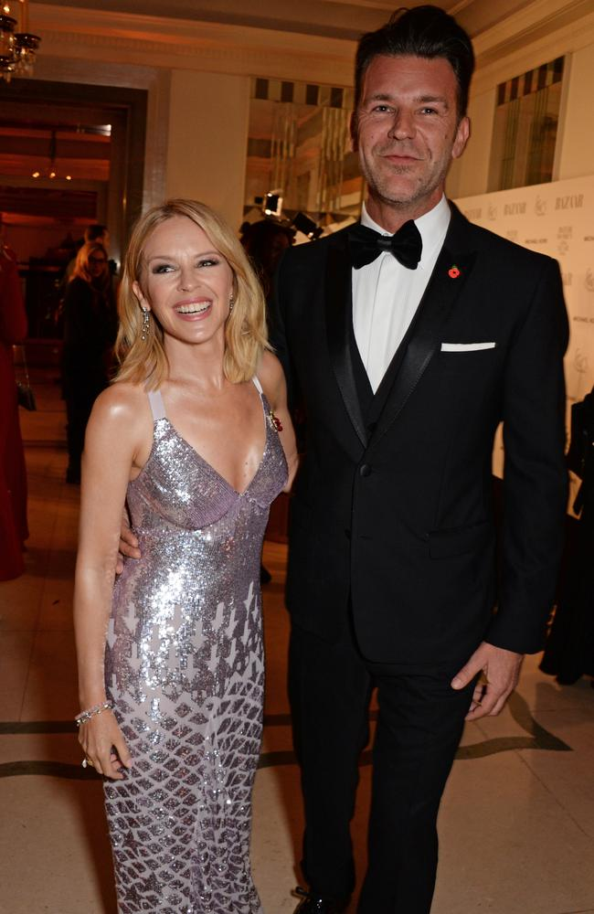 Kylie Minogue glows as she poses with her new boyfriend Paul Solomons. Picture: Dave Benett/Getty Images