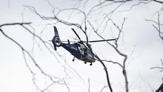 The Victoria Police Air Wing division was called to assist in the search of an 11-year-old boy who was missing in dense bushland. Picture: Sarah Matray