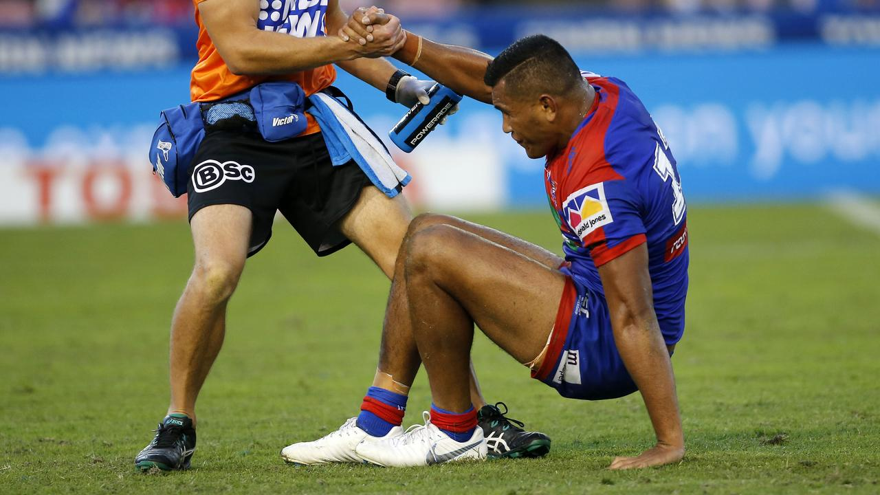 Daniel Saifiti is helped to his feet during the Round 1 NRL match with Cronulla