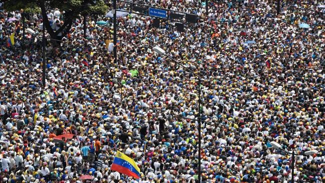 Anti-government demonstrators rally in Caracas after a day of violent clashes on the streets of the capital.
