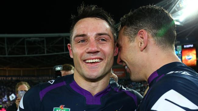 Cooper Cronk and Billy Slater celebrate winning the 2017 NRL Grand Final. Pic: Adam Head