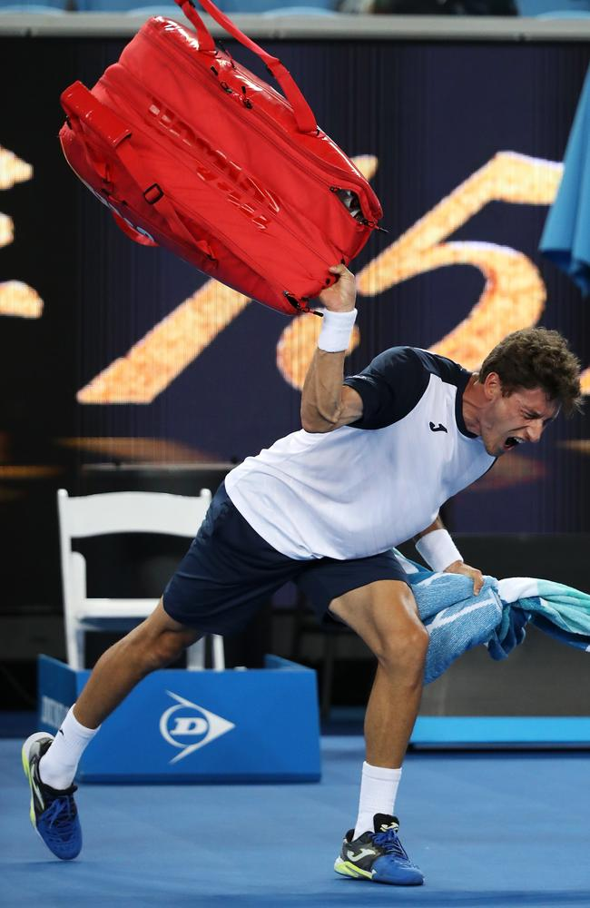 Pablo Carreno Busta of Spain throws his bag as he shows his frustration after defeat in his fourth round match against Kei Nishikori of Japan. Picture: Mark Kolbe/Getty Images