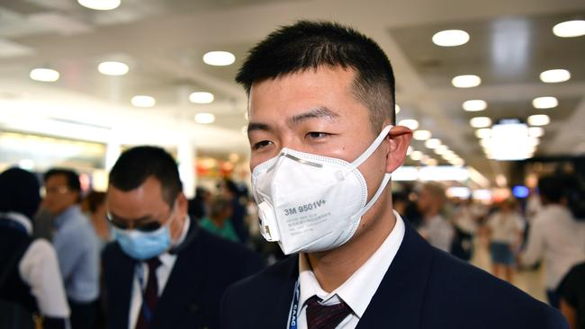 China Eastern Airlines flight crew wearing protective masks on arrival at Sydney airport on Thursday. Picture: AAP