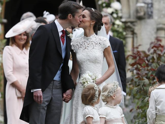 Pippa Middleton and James Matthews kiss after their wedding. Picture: AP