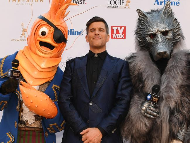 Osher Gunsberg and characters from the The Masked Singer at the 2019 Logies. Picture: AAP Image/Dan Peled