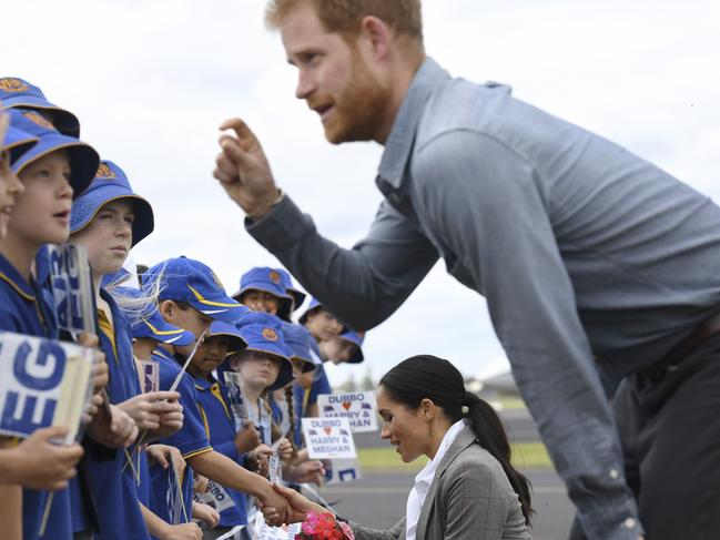 Always a jokester, Prince Harry is probably explaining something funny here. Picture: Dean Lewins/AFP