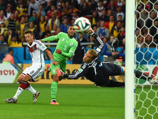 Faouzi Ghoulam of Algeria sends a shot wide against Germany.