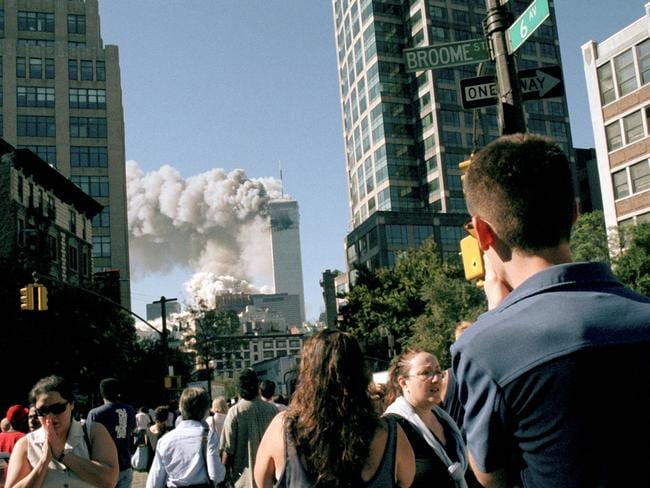 People watch from Sixth Ave in Soho as the towers collapse. Picture: Alamy