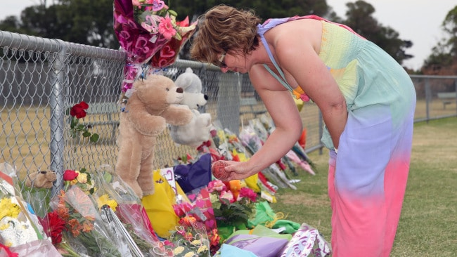 Luke Batty's murder in Tyabb, with flowers being laid in his memory on the oval where the incident occurred. Luke's mum Rosie Batty arrives and looks through all the flowers and cards.