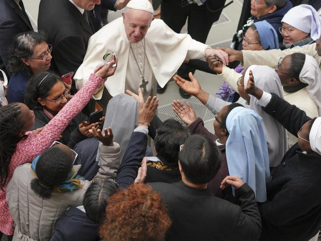 Pope Francis is greeted by a group of nuns during the weekly general audience he held at the Vatican last month. Picture: AP Photo/Andrew Medichini