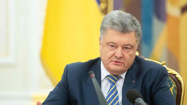 President of Ukraine Petro Poroshenko has successfully called for martial law to be imposed in some regions. Picture: Mykhailo Markiv / AFP.