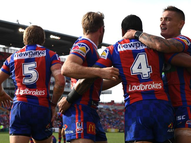 The Knights celebrate a Peter Mata'utia try.