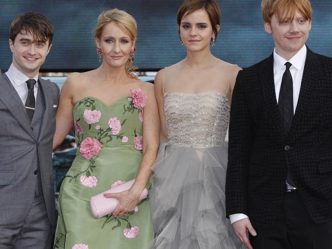 JK Rowling, pictured with the cinematic stars of Harry Potter, Daniel Radcliffe, Emma Watson and Rupert Grint in 2011. Picture: AP Photo/Joel Ryan