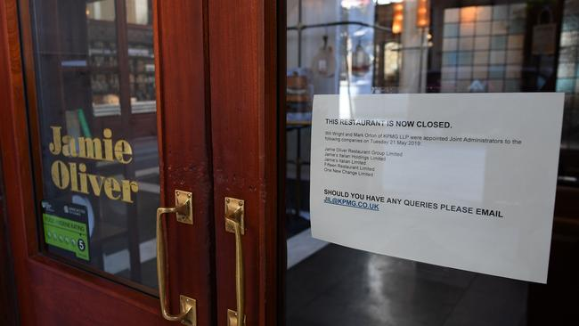 A sign in the door of a closed-down Jamie's Italian restaurant in Manchester, northern England on May 21, 2019, notifies people the KMPG have been appointed as administrators to the Jamie Oliver Restaurant Group. Picture: Paul Ellis/AFP