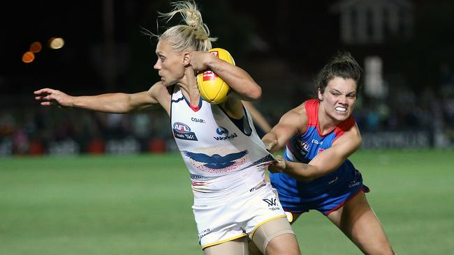 Erin Phillips tries to spin out of an Elle Blackburn tackle. Picture: Wayne Ludbey