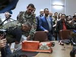 A pro-Russia separatist shows members of the media a black box belonging to Malaysia Airlines flight MH17, before handing it over to Malaysian representatives during a press conference in Donetsk. Rebels controlling the crash site of Malaysian flight MH17 on July 22 handed over the plane's black boxes, and declared a localised truce to allow international experts full access to the forensic minefield in east Ukraine. Dutch investigators leading a probe into the disaster were preparing to take charge of the bodies of 280 victims set to arrive by train in the government-controlled city of Kharkiv. Picture: AFP PHOTO