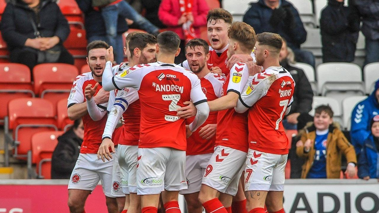 Harry Souttar (3R) celebrates with his Fleetwood Town teammates. Credit: Fleetwood Town FC.