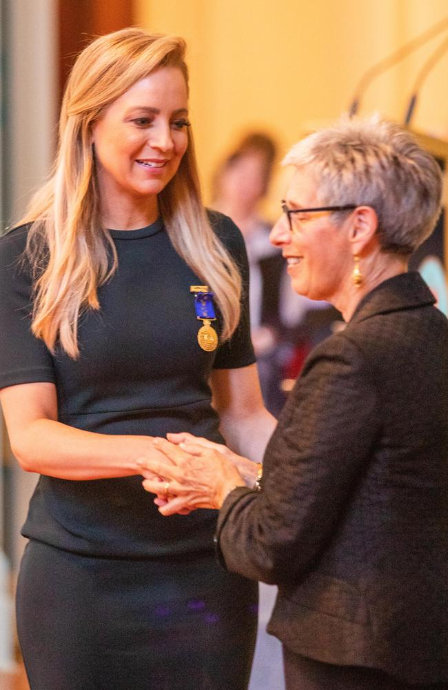 Moments before the medal went missing, Carrie Bickmore receives her 2019 Queens Birthday Honour medal from Victorian Governor Linda Dessau. Picture: Getty.