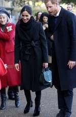 Prince Harry and his fiancée Meghan Markle meet up with children as they arrive to a walkabout at Cardiff Castle on January 18, 2018 in Cardiff, Wales. Picture: Getty