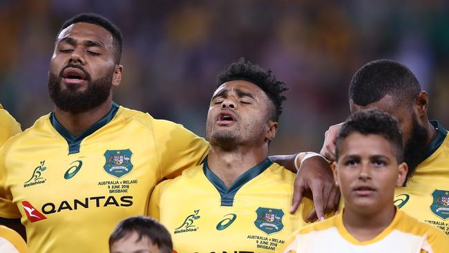 Samu Kerevi and Will Genia of the Wallabies belt out Australia's national anthem.