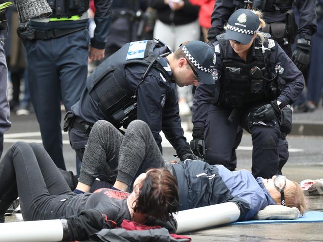 Activists from Extinction Rebellion in a protest in Melbourne where some protesters glued themselves to the road. Picture: AAP/David Crosling