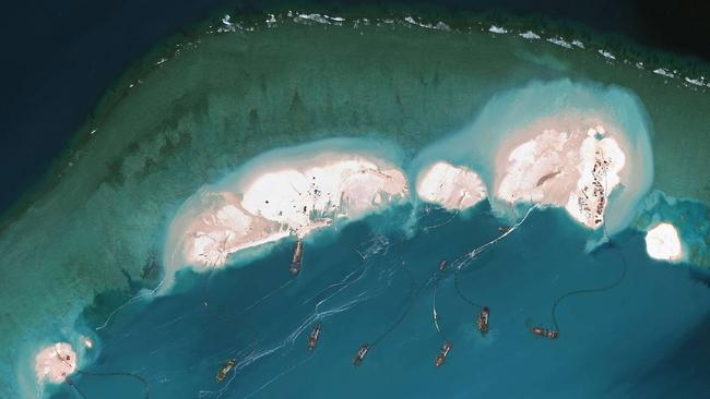 Flashpoint: Satellite-imagery provider DigitalGlobe shows what is believed to be Chinese vessels dredging sand at Mischief Reef in the Spratly Islands in the South China Sea. Picture: Agence France-Presse/Getty Images