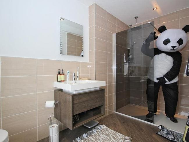 He shows off the bathroom, still dressed up in panda mode. Picture: Quick & Clarke