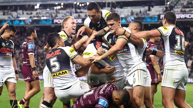 The Panthers celebrate after Bryce Cartwright of the Panthers scored a try.