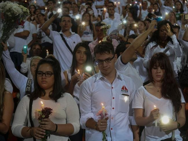 People take part in a tribute to the victims