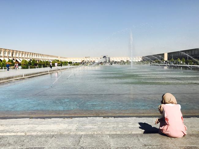 A woman sits by fountains in Isfahan, one of Iran's busiest cities. Picture: Rohan Smith