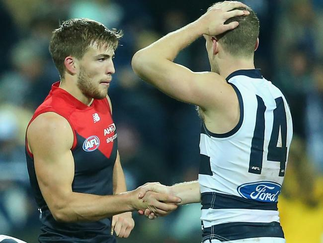 Jack Viney shakes hands with Joel Selwood after the match. Photo by Quinn Rooney.