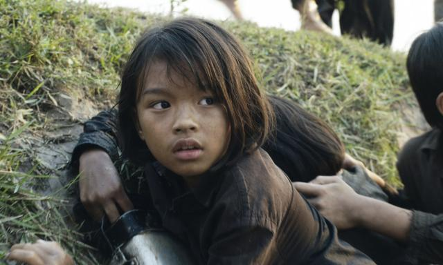 """This image released by Netflix shows Sareum Srey Moch in a scene from """"First They Killed My Father: A Daughter of Cambodia Remembers."""" (Netflix via AP)"""