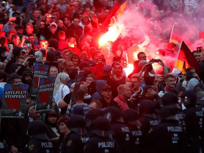 Right wing demonstrators light flares in nearby Chemnitz last year. Picture: AFP