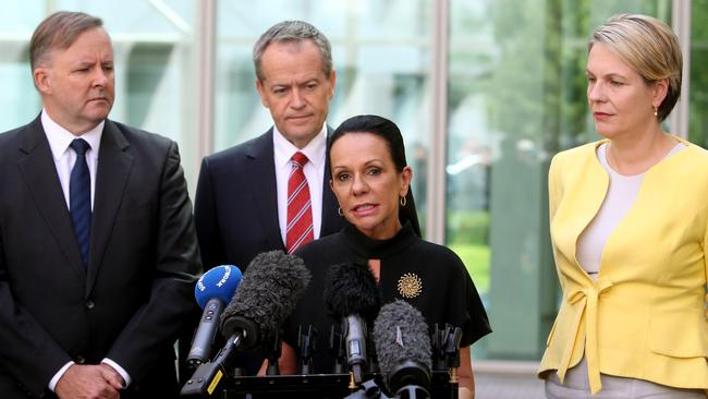 Linda Burney makes a speech at Parliament House as Bill Shorten (centre), Anthony Albanese (left) and Tanya Plibersek (right) watch on.