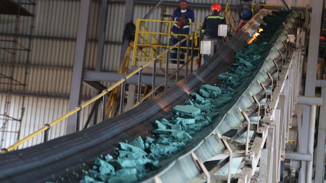 A conveyor belt carries chunks of raw cobalt being exported to China for refining. Picture: AFP Photo / Samir Tounsi