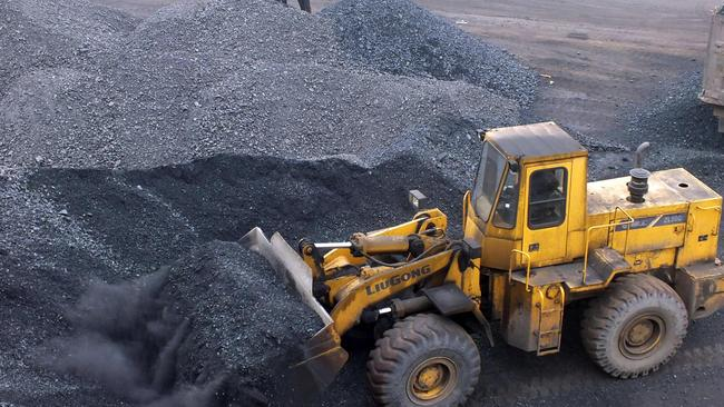 An excavator moves coal at a Chinese port. Picture: AFP
