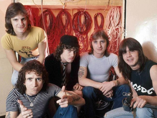 AC/DC photographed in 1976: Mark Evans, Bon Scott, Angus Young, Phil Rudd and Malcolm Young. Picture: Scope