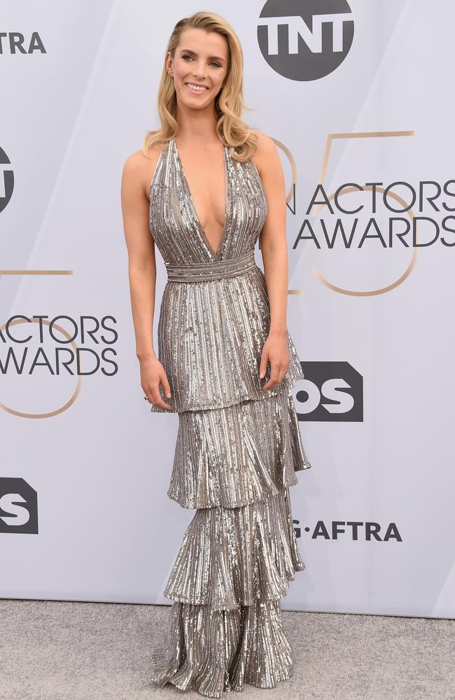 Betty Gilpin wears a silver beaded gown. Picture: Gregg DeGuire/Getty Images for Turner