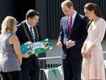 Prince William and his wife Kate receive a skateboard with the name George written on it, from Playford Mayor Glenn Docherty. Gues who that's for? Picture: Tricia Watkinson.