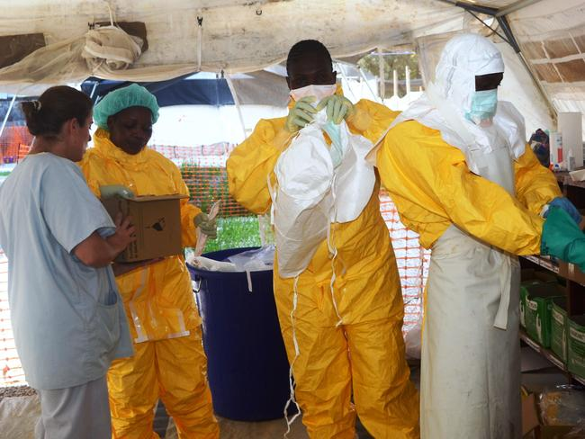 Running rampant ... Médecins Sans Frontières (MSF) staff dress in protective gear at the isolation ward of the Donka Hospital in Conakry, where people infected with the Ebola virus are being treated. Picture: Cellou Binani