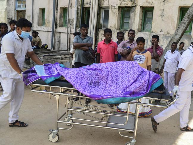 Sri Lankan hospital workers transport a body on a trolley at a hospital morgue following an explosion at a church in Batticaloa in eastern Sri Lanka on April 21, 2019. Picture: AFP