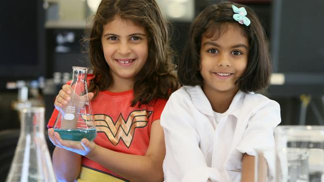 Amelia, 8, and Avanti, 5, are attending Superhero Daughter Day. Picture: Emma Brasier/AAP
