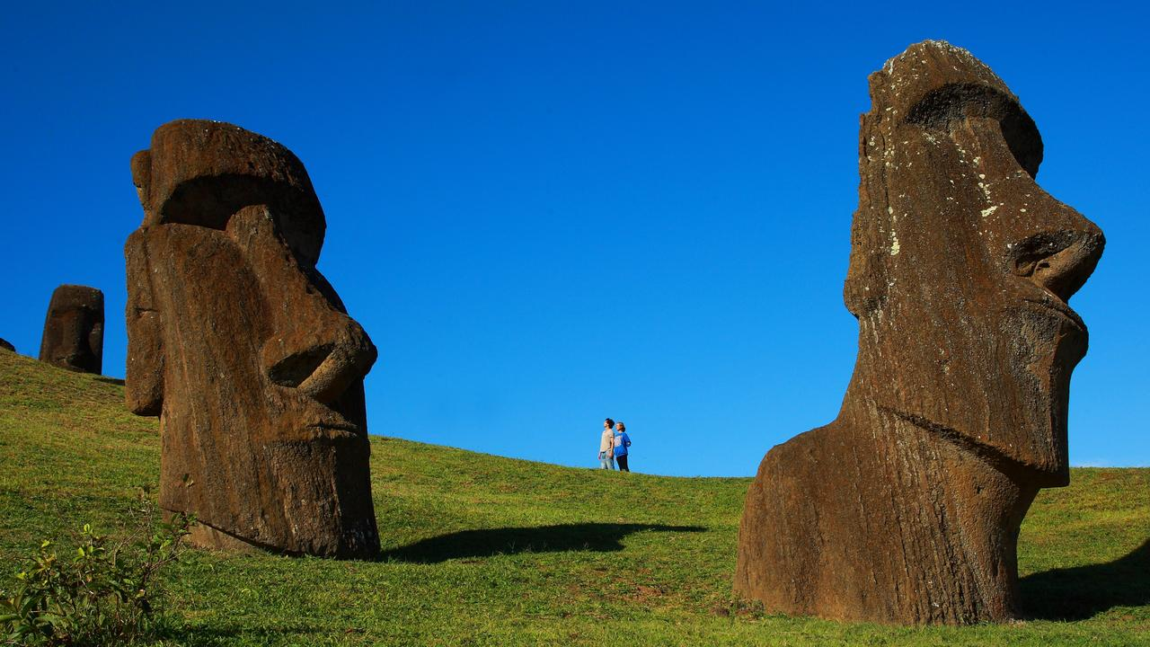 Moai on Easter Island. You can get an idea of how big they are by looking at the two people in the background. Picture: supplied