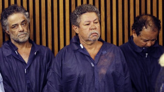 Onil Castro, left, Pedro Castro, centre, and Ariel Castro, right, wait for their arraignment at Cleveland Municipal Court in Cleveland, Ohio.