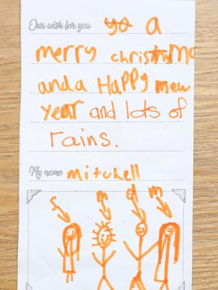 """Mitchell's card with his wish of """"lots of rain"""". Picture: Tim Hunter."""