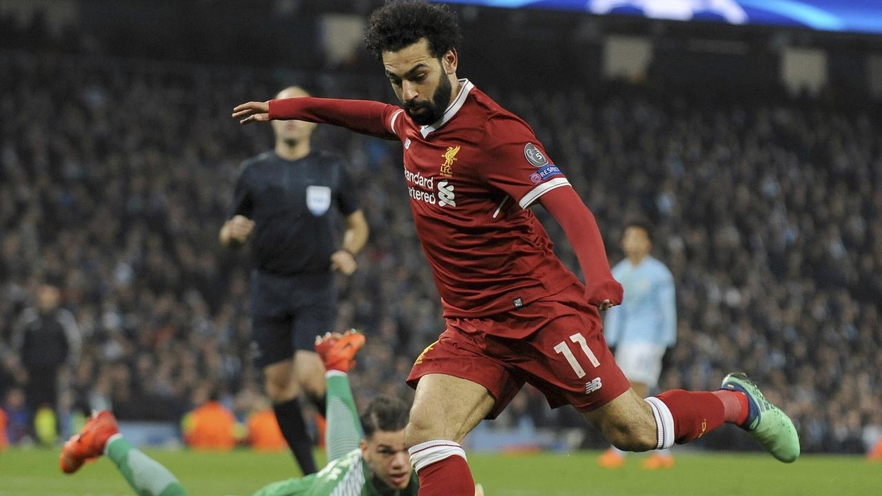 Liverpool's Mohamed Salah scores past Manchester City's Ederson.