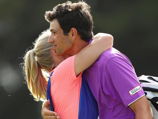 A hug from Jordan Zunic's girlfriend and caddy Olivia Marlow eases the pain.